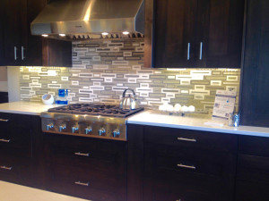 Creative tile backsplash in open kitchen.