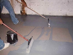 Applying Epoxy Floor Covering. Photo courtesy of epoxyproducts.com.