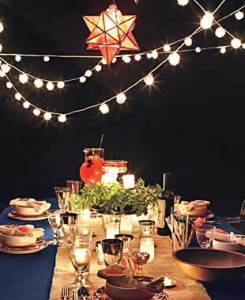 Festive backyard lighting. Photo courtesy of rachaelraymag.com.