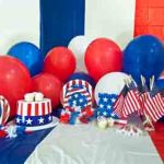 Red, White, and Blue party balloons and hats to celebrate Independence Day. Photo courtesy of homeseasons.com.